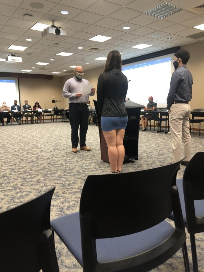 Swearing In: Luiz Alcantra and Ana Estrada-Varges are both sworn into WSGA cabinet. The WSGA met for their weekly meeting Sept.15 in the Kansas Room on the upper floor of the Memorial Union.