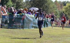 Fly to the finish: Sophomore David Kibet rounds a corner and creates distance on opponents. Kibet finished with a time of  25:08.52 on Sep. 18, 2021 at the Missouri Southern Stampede.