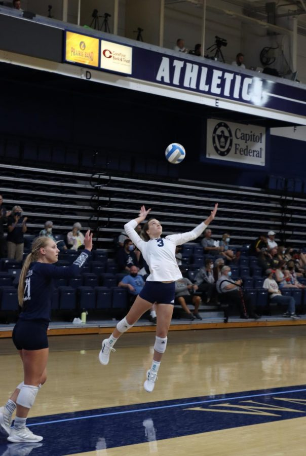 Picture perfect: Junior Jaycee Burghart setting up her jump serve.