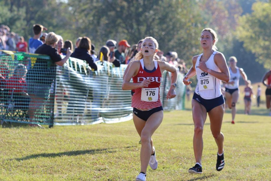 Keep going: Senior Sierra Mortensen (right) looks to make a strong push before the finish. Mortensen finished with a time of 17:53.09 at the meet on Sept. 18, 2021.
