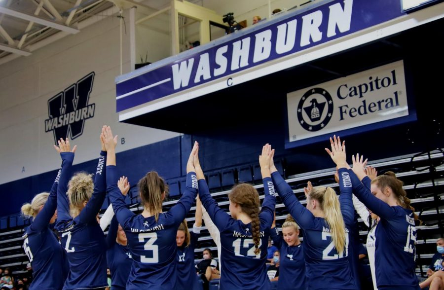 Team+work%3A+The+team+puts+their+hands+up+in+celebration+of+winning+their+first+set+of+the+season+on+its+way+to+a+3-0+match+victory.