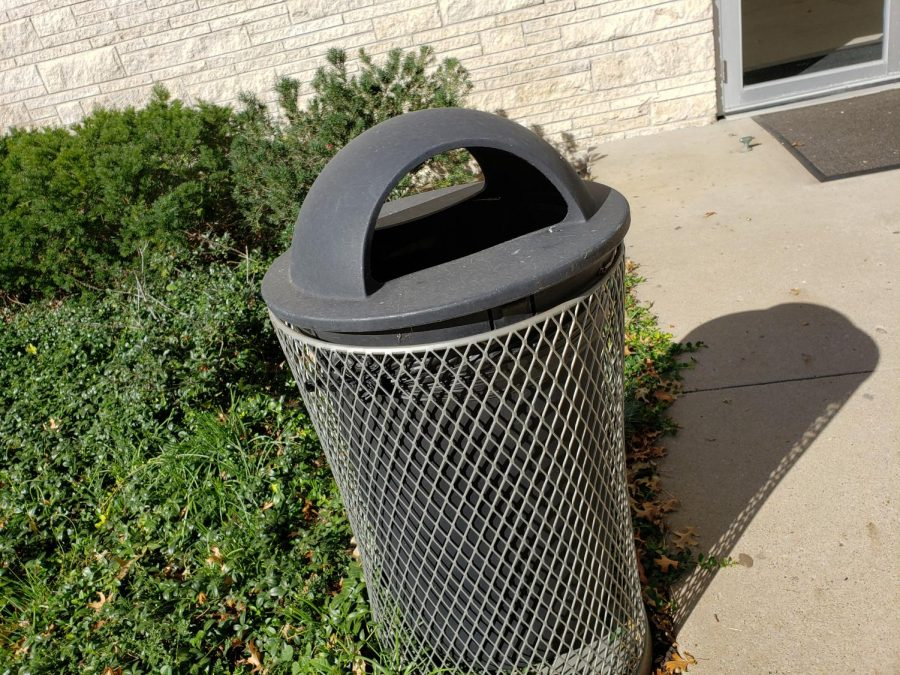 The Average Trash Can - Trash can stands outside of Garvey Fine Arts Center. Trash cans are a large aggregator of food waste.