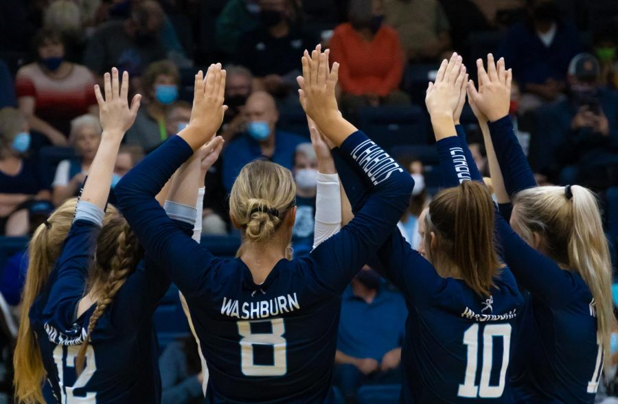 Huddle up: The Ichabods come together for a huddle during a time-out in the match against Emporia State on Sept. 21, 2021. Washburn took all three sets of the match.