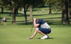 Steady does it: Junior Dawson Wills lines up his shot before making a put on September 13, 2021 at the Washburn Invitational.