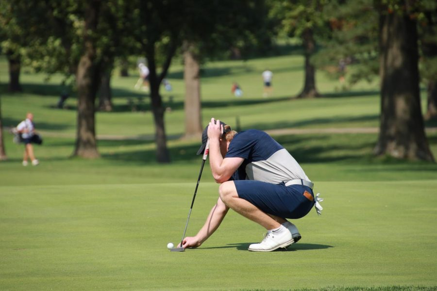 Steady+does+it%3A+Junior+Dawson+Wills+lines+up+his+shot+before+making+a+put+on+September+13%2C+2021+at+the+Washburn+Invitational.