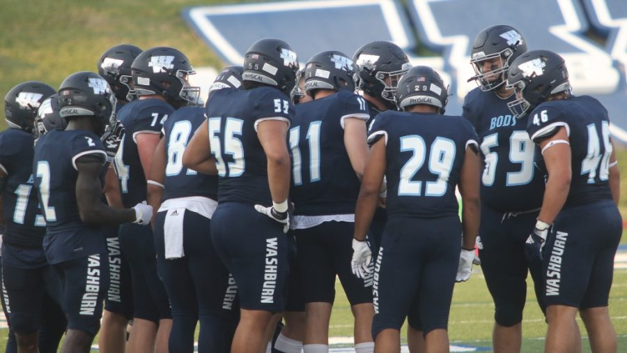 Huddle up: Washburn's offense huddles up during a timeout in the first quarter of the Ichabods 29-10 win over Central Missouri.