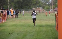 Finish strong: Sophomore Patricia Koma runs toward the finish on her way to winning the race with a time of 18:54.