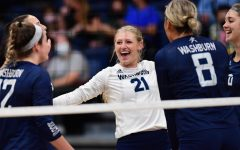 Celebration: Washburn University defensive specialist Faith Rottinghaus (21) celebrates after a point. The Ichabods swept Emporia State 3-0 on Tuesday, Sept. 21, 2021, at Lee Arena in Topeka, KS.