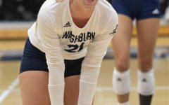 High energy: Washburn libero Faith Rottinghaus celebrates after scoring a point Thursday, Oct. 21, 2021, at Lee Arena in Topeka, Kansas. Rottinghaus finished the match with 31 digs.