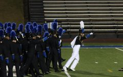 The first step: A band conductor runs onto the field, leading the way. The Washburn Rural Marching Jr. Blues were led by Luke Chaffee, Chris Exum, and Meredith Casey.