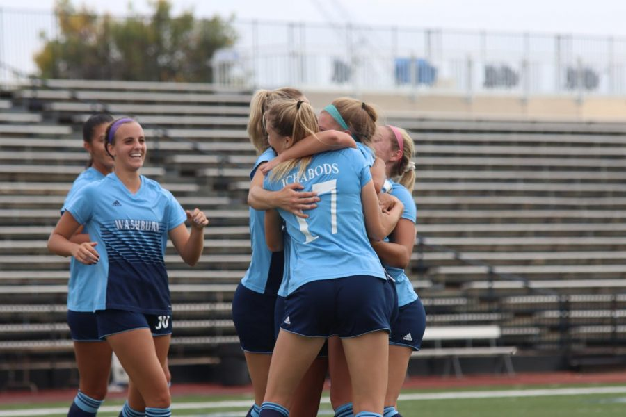 Celebration: Members of the team hug each other after scoring a goal on Oct. 10, 2021. Washburn defeated Rogers State 3-1 in the match.