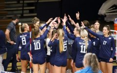 Hands in: The team celebrates after winning a set on Oct. 19, 2021. The Ichabods swept Fort Hays State 3-0 in the match.