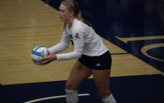 Lob it up: Senior libero Faith Rottinghaus(23)  prepares to throw the ball up on a serve on Oct. 1, 2021. Rottinghaus finished with 14 digs in the match.