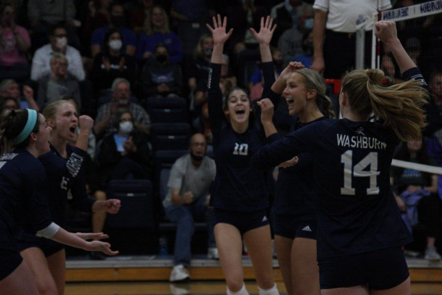 Hands up: The team celebrates winning a point early in the first set on Oct. 12, 2021. The Ichabods would come from behind to win the first set 25-22 over Nebraska at Kearney.