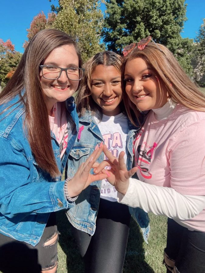 Throw what you know: Members of Zeta Tau Alpha throw up their crown hand sign at the pink out tailgate Oct. 16, 2021. Students filled their calendars with philanthropy week events.