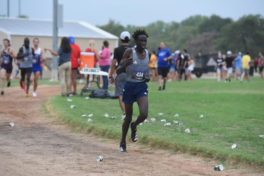 Run, run, run: Sophomore David Kibet runs on his way to finishing fifth in the four-mile race.
