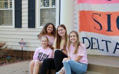 Hanging out: Delta Gamma members hang around at the start of the block party on Wednesday, Oct. 6, 2021. The block party was a way to raise money for Delta Gammas philanthropy, Service for Sight.