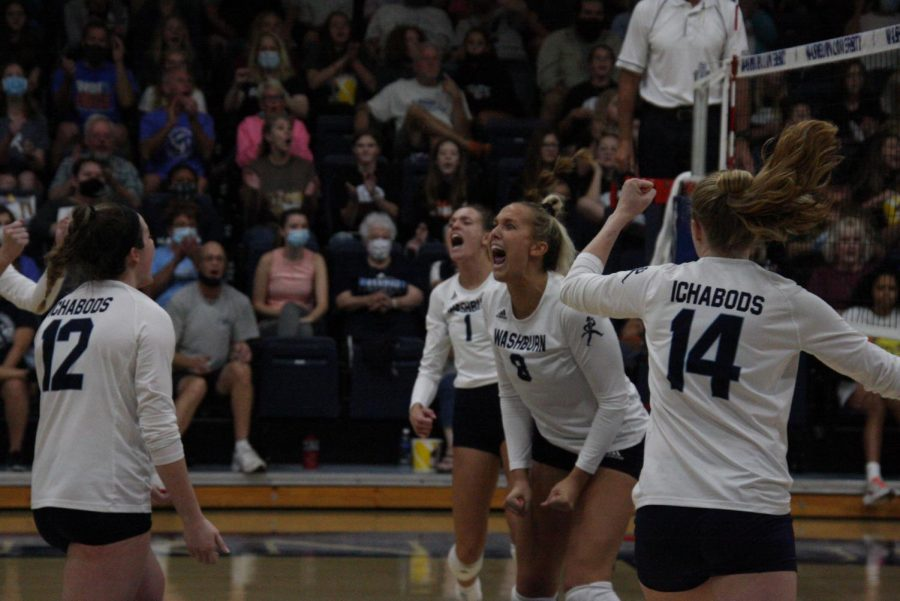 Big kill: Senior middle hitter Allison Maxwell (8) celebrates after making a kill on Oct. 9, 2021. Maxwell finished the match with 15 kills.