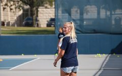 With foresight and leadership: Graduate Assistant Logan Morrissey surveys warmup at practice on Oct. 7, 2021. Morrissey finished her playing eligibility at Washburn with a school wins record.