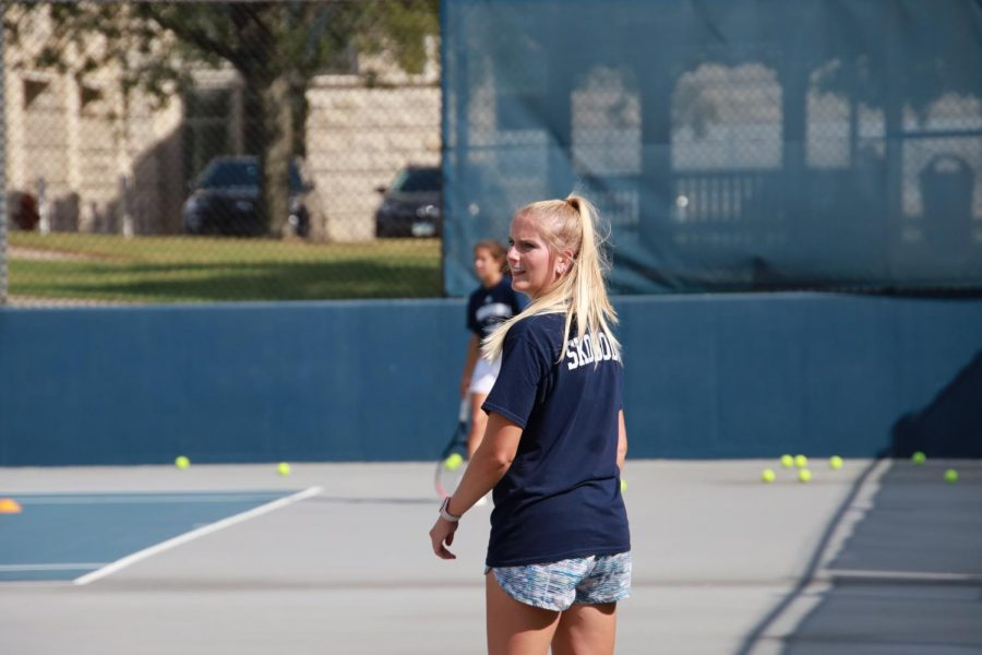 With+foresight+and+leadership%3A+Graduate+Assistant+Logan+Morrissey+surveys+warmup+at+practice+on+Oct.+7%2C+2021.+Morrissey+finished+her+playing+eligibility+at+Washburn+with+a+school+wins+record.