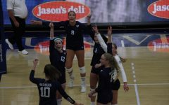 High energy: The team celebrates freshman outside hitter Jalyn Stevenson  after she makes a kill on Oct. 12, 2021. The Ichabods would defeat the Lopers in three sets in the match.
