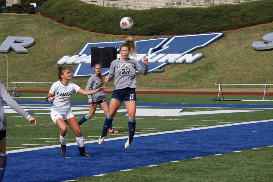 Heads up: Sophomore defender Emily Michaelis heads a ball near the sideline on Oct. 24, 2021. Michaelis played all 90 minutes of the Ichabods 1-0 victory.