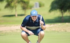 Down low: Sophomore Cade Uhlenhake kneels down to position his next shot on Sept. 13, 2021.