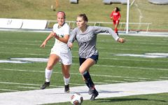 Down the line: Senior defender Olivia Harriger dribbles the ball near the sideline on Oct. 24, 2021. Harriger scored the only goal of the match in Washburns victory.
