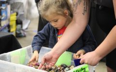 Lenora and her mother Bobbi Broyles attend the mineral show where Lenora can learn about rocks, while identifying ones out of a tub.