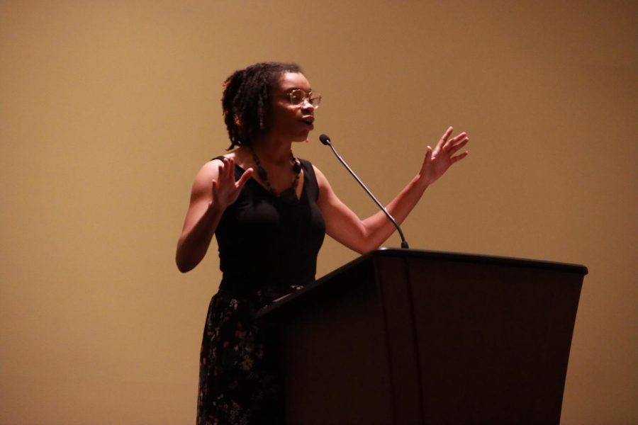 Poet at work: Jae Nichelle orchestrates a haiku collaboration with the audience. Nichelle performed Wednesday, Oct. 13, 2021 at the Bradbury Thompson Alumni Center.