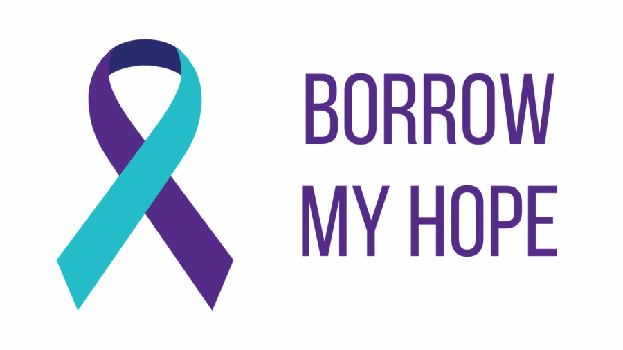 The teal-and-purple ribbon commemorates lives lost to suicide.